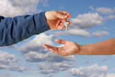 Handing Over the Keys on Clouds — Stock Photo