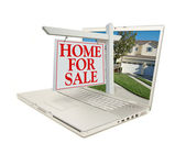Home for Sale Sign Coming Out of Laptop — Stock Photo