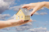 Reaching For A Home on Clouds and Sky — Stock Photo