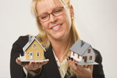 Woman Holding Two Houses — Stock Photo