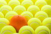 Set of Brand New Tennis Balls and Orange — Stock Photo