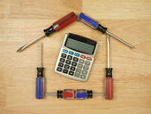 House Shaped by Screwdrivers, Calculator — Stock Photo