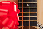 Guitar Strings with Red Ribbon — Stock Photo