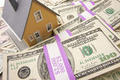 Home with Stacks of Money — Stock Photo