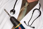 Arts met een stethoscoop en boor — Stockfoto