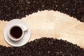 Dark Roasted Coffee Beans and Cup — Stock Photo