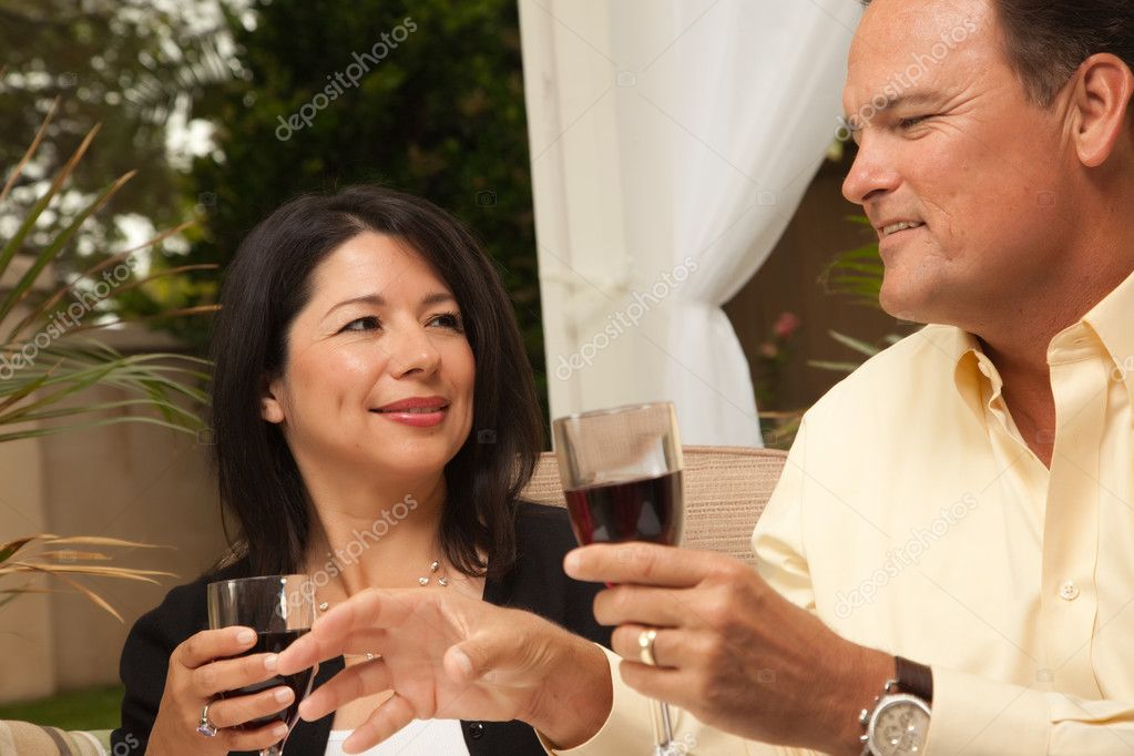 Hispanic Woman and Caucasian Man Enjoying Wine on the Patio. — Stock Photo #2350094