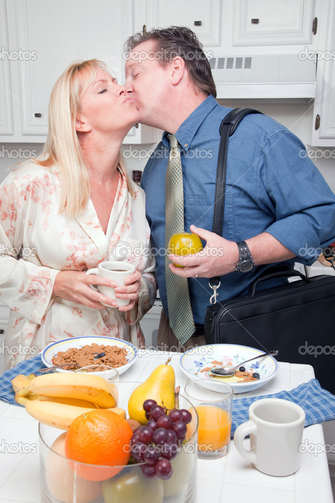 Businessman Ready for Work Kisses Wife In Kitchen. — Stock Photo #2354339