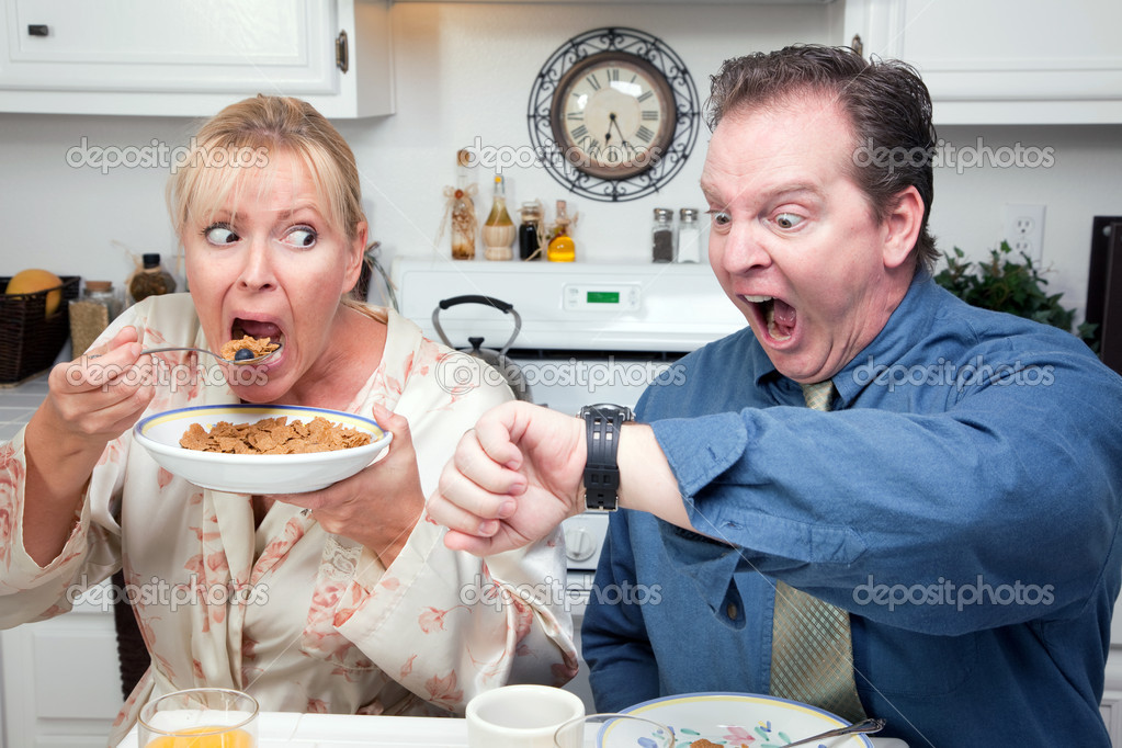 Late for Work Stressed Couple Checking Time in Kitchen.  Stock Photo #2354469