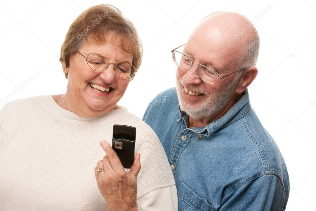 Happy Senior Couple Using Cell Phone Isolated on a White Background.  Stock Photo #2354836