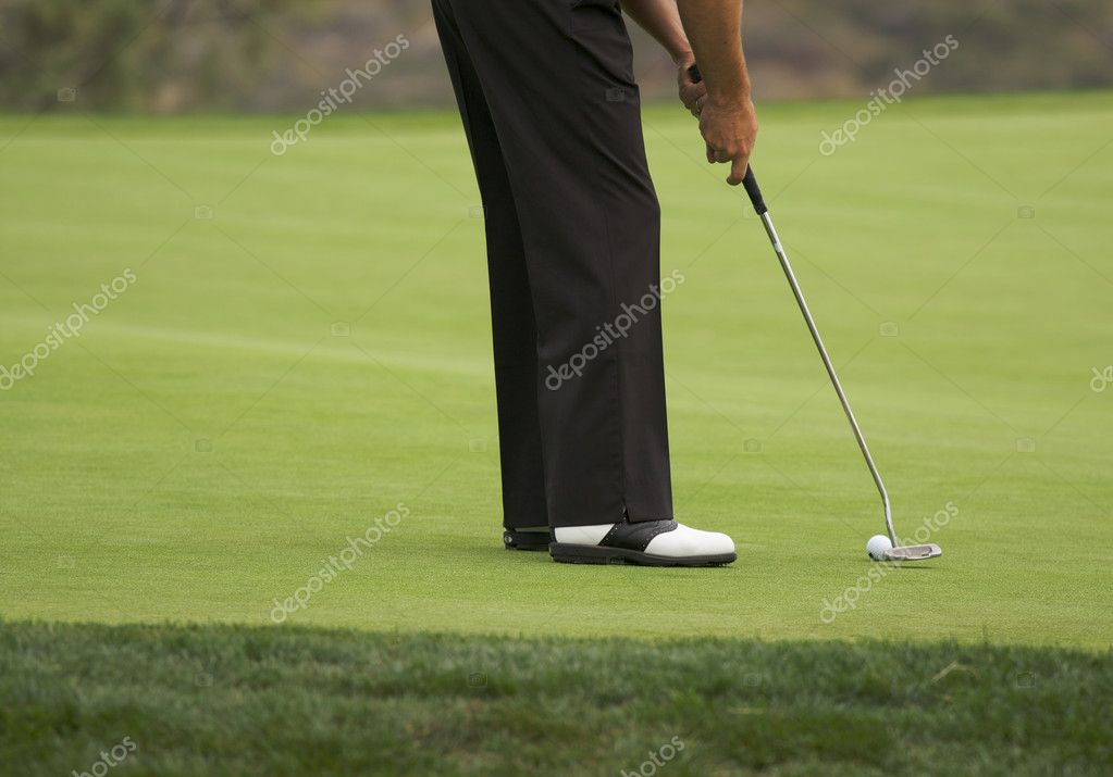 Golfer Putting on the Green one Summer Day.  Foto Stock #2356386