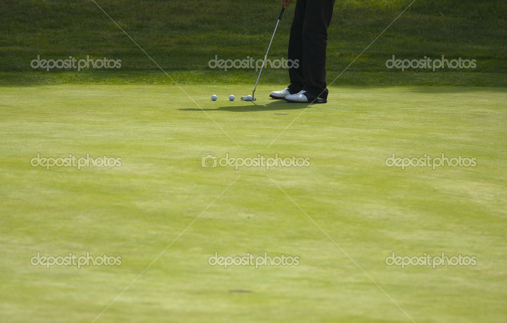 Golfer Putting on the Green one Summer Day. — Stock Photo #2356416