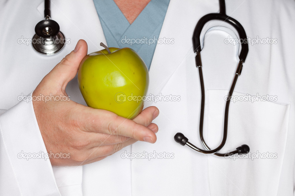 Male Doctor with Stethoscope Holding Green Apple. — Stock Photo #2358006