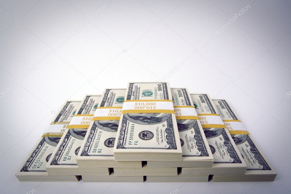 Ten Thousand Dollar Piles of One Hundred Dollar Bills Built in a Pyramid. — Stock Photo #2358009