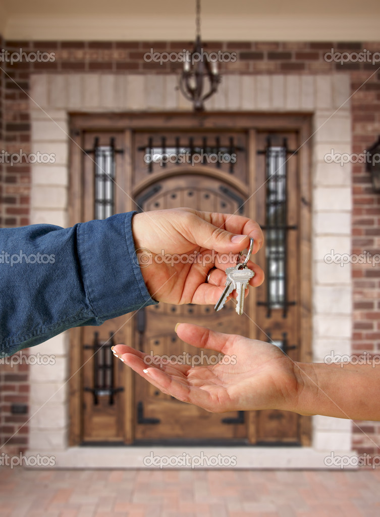 Handing Over the Keys to A New Home in Front of Beautiful Front Door of House — Stock Photo #2358896
