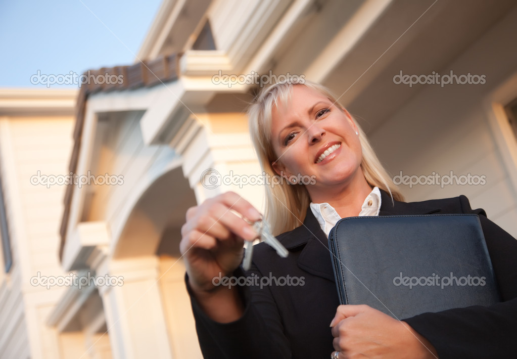 Female Real Estate Agent Handing Over Keys in Front of Beautiful House. — Stock Photo #2358909