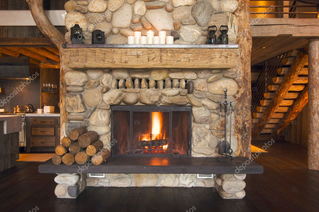 Rustic Fireplace in Log Cabin  Stock Photo #2359174