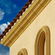 Stock Photo: Stucco Wall Arched Windows and Clouds