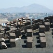 New Home Construction Site Roof with Stacks of Tiles - Стоковая фотография