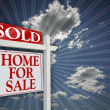 Постер, плакат: Sold Home For Sale Sign on Clouds