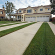 Modern Home Facade and Driveway - Stock Photo