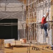 Carpenter Climbing Down Scaffolding — Stockfoto