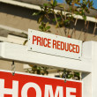 Price Reduced Real Estate Sign - Stock Photo