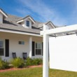 Blank Real Estate Sign and New Home — Stock Photo
