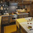 Rustic Fully Equipped Log Cabin Kitchen - Stock Photo