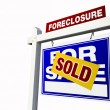 Royalty-Free Stock Photo: Blue Sold Foreclosure Sign on White