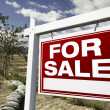 For Sale Real Estate Sign and Empty Lot — Stock Photo