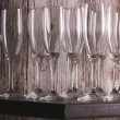 Champagne Flutes on Shelf Abstract - Stock Photo