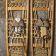 Stock Photo: Antique Snowshoes on Rustic Cabin Wall