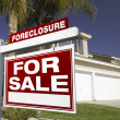 Red Foreclosure Sign in Front of House — Stock Photo #2367327