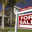 Stock Photo: Red Foreclosure Sign in Front of House