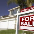 Red Foreclosure Sign in Front of House — Stock Photo