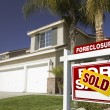 Red Sold Foreclosure Sign and House — Stock Photo #2367511