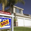 Stock Photo: Sold Foreclosure Real Estate Sign