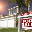 Red Foreclosure Sign and House — Stock Photo