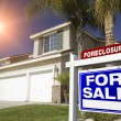 Blue Foreclosure For Sale Sign and House — Stock Photo