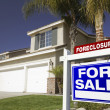 Blue Foreclosure Sign and House — Stock Photo #2367589