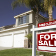 Red Foreclosure Sign and Home — Stock Photo #2367599