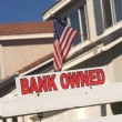 Bank Owned Real Estate Sign and House — Stock Photo #2367889