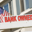 Bank Owned Real Estate Sign and House — Stock Photo #2367928