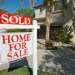 Sold Home For Sale Sign and New House — Stockfoto #2368108