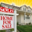 Постер, плакат: Sold Home For Sale Sign and New House