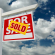 Stock Photo: Sold For Sale Real Estate Sign on Clouds