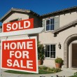 Sold Home For Sale Sign in front of Home — Foto de Stock