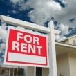 For Rent Sign in Front of New Home - Stock Photo