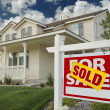 Stock Photo: Sold Real Estate Sign in Front of House
